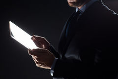 Close up of businessman with transparent tablet pc Stock Photo