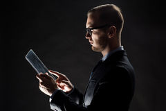 Close up of businessman with transparent tablet pc Royalty Free Stock Image