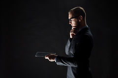 Close up of businessman with transparent tablet pc Stock Images