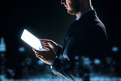 Close up of businessman with transparent tablet pc Royalty Free Stock Photos