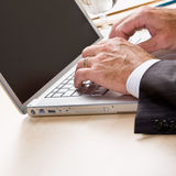 Close up of businessman typing on laptop Stock Photo