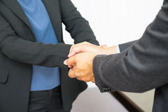 Close up businessman use two hand holding businesswoman hand for Stock Images