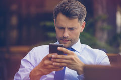 Close up of businessman using mobile phone Stock Photo