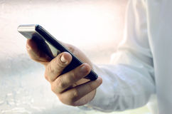 Close up of a businessman using smart phone Royalty Free Stock Photo