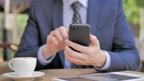 Close Up of Businessman Using Smartphone. The Close Up of Businessman Using Smartphone, high quality stock video footage