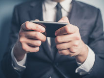 Close up on businessman using smartphone Stock Photography