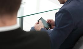 Close up.businessman using smartphone in the workplace royalty free stock images