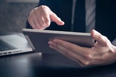 Close up of Businessman using tablet on the office desk. royalty free stock images