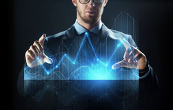 Close up of businessman with virtual diagram Royalty Free Stock Photo