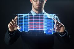 Close up of businessman with virtual projection. Architecture, technology and construction concept - close up of businessman with virtual building blueprint Stock Image