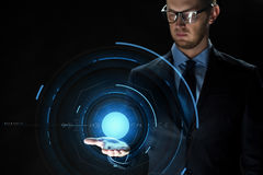 Close up of businessman with virtual projection. Business, virtual reality, future technology and people concept - close up of businessman in suit with Stock Images
