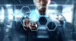 Close up of businessman with virtual screen. Business, technology and network concept - close up of businessman in suit working with hexagonal hologram on Stock Photography