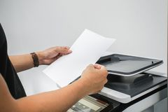 Businessman with waist watch hold paper sheet for printer copying and scanning. Close up businessman with waist watch hold paper sheet for printer copying and royalty free stock photos
