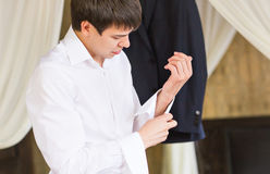 Close up of businessman wearing cufflinks. Elegant young fashion business man Stock Image