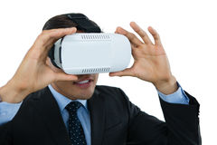 Close up of businessman wearing vr glasses. Against white background Stock Photo