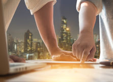 Close up Businessman and woman hand discussing on stockmarket ch. Arts in office with hong kong night cityscape background Royalty Free Stock Images