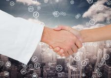 Close-up of businessman and woman shaking hands with each other. Against digitally generated background Stock Photography