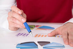 Close-up from businessman working with evaluations. Royalty Free Stock Photo