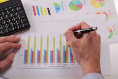 Close up of businessman working on  financial data in form of charts and diagrams. Business statistics and success concept Stock Photo
