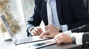 Close-up.businessman working with laptop at his Desk. Royalty Free Stock Photos