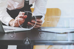 Close up of businessman working with smart phone and digital tab Royalty Free Stock Photo