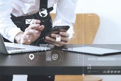 Close up of businessman working with smart phone and digital tab Stock Photo