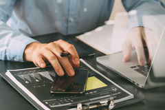 close up of businessman working with smart phone and digital tab Stock Photos