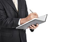 Close up of businessman writing a note with white backgound. royalty free stock photo