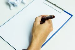 Close-up Of A Businessman writing on a notebook, Royalty Free Stock Image
