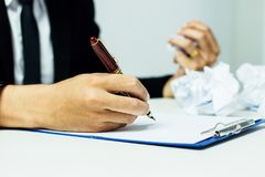 Close-up Of A Businessman writing on a notebook, Royalty Free Stock Images