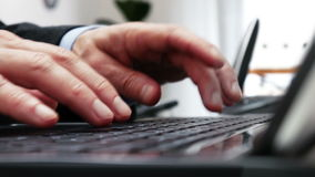 Close-up of businessmans hands typing on laptop keyboard - 4k stock video