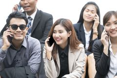 Close up of businessmen and businesswomen using smartphone stock photos