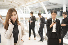 Close up of businessmen and businesswomen using smartphone royalty free stock photos