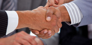 Close-up of businessmen closing a deal. In a meeting Stock Photo