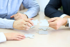 Close-up Of Businessmen Hand Connecting Jigsaw Puzzle Stock Photography