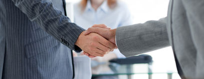 Close-up of businessmen shaking hands stock photo