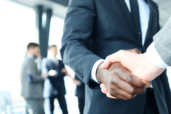 Close up of the businessmen shaking hands. Royalty Free Stock Images