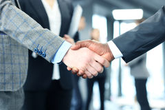 Close up of the businessmen shaking hands. Royalty Free Stock Photo