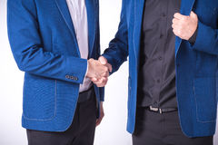 Close up of businessmen shaking hands business success ideas con Stock Photos