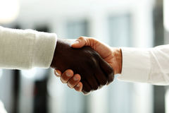 Close-up of businessmen shaking hands, Stock Images