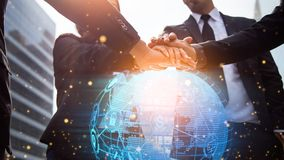 Close up of businessmen shaking hands. Global network and a world map in the foreground. block chain concept. royalty free stock photography