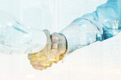 Close up of businessmen shaking hands, toned royalty free stock photography