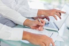 Close up on businessmens hands working together Royalty Free Stock Image