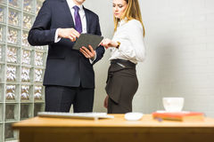Close-up of Businesspeople With Digital Tablet Sitting In Modern Office Royalty Free Stock Photo