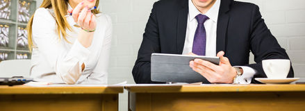 Close-up of Businesspeople With Digital Tablet Sitting In Modern Office Royalty Free Stock Image