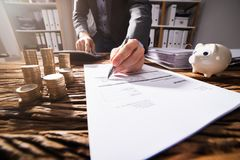 Close-up Of A Businessperson`s Hand Signing Document stock images