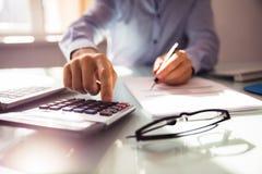 Businessperson Using Calculator royalty free stock photos