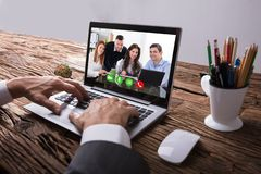 Businessperson Video Conferencing With Colleague On Laptop stock photos