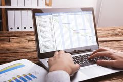 Businessperson Working With Gantt Chart On Laptop royalty free stock photo