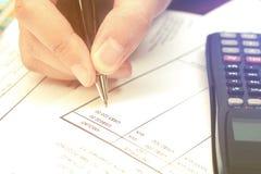 Close up businesswoman calculating data analyzing in office. Close up businesswoman calculating data analyzing in office Stock Photo